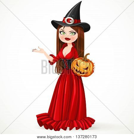 Beautiful witch in a red dress holding a pumpkin showing hand aside isolated on a white background