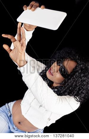 Young African American Girl In White Sweater Takes A Selfie
