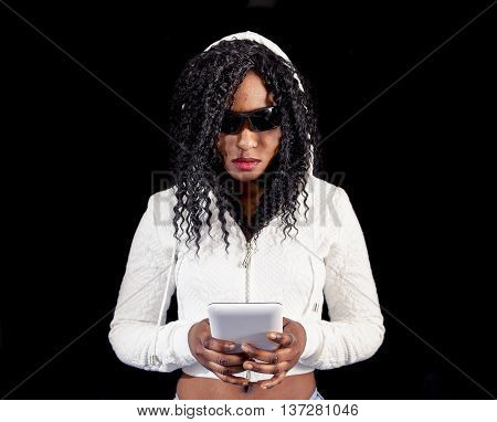 Young African American Girl In White Hoodie Type A Message On Smart Phone
