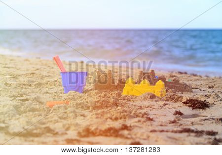 kids toys on tropical sand beach, family vacation