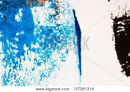 Closeup view of abstract hand painted blue and black acrylic art background on paper texture