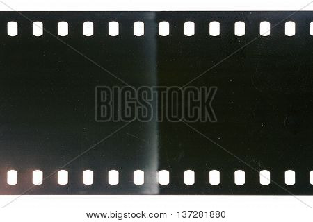 Blank scratched noisy gray filmstrip isolated on white background