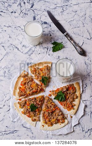 Traditional Asian thin tortilla with minced meat and vegetables. Selective focus.