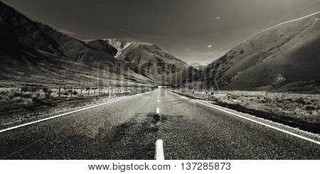 Continuous Road Scenic Mountain Ranges Afar Concept
