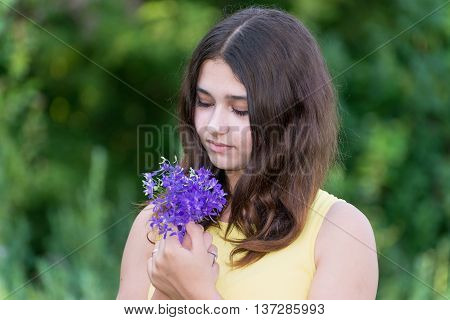 Girl 14 years old with a bouquet of wildflowers