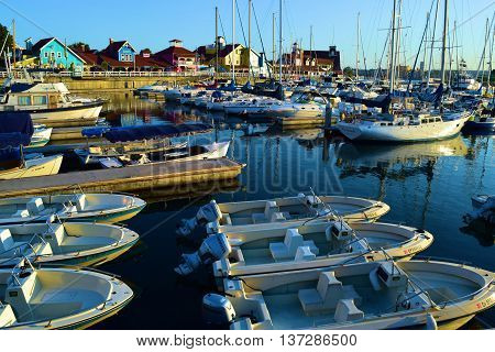 June 20, 2016 in Long Beach, CA:  Row of rental boats docked at the Long Beach Harbor where people can enjoy traveling on the rental boats in the bay and marina taken at Shoreline Village in Long Beach, CA