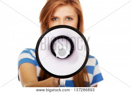 Screaming young teenage woman with megaphone