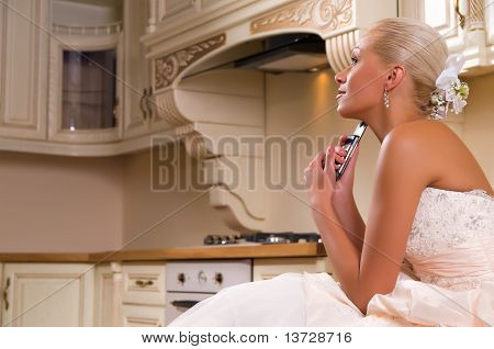 Bride Sitting In The Kitchen