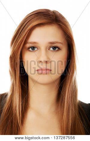 Sad or worried teenage pretty woman