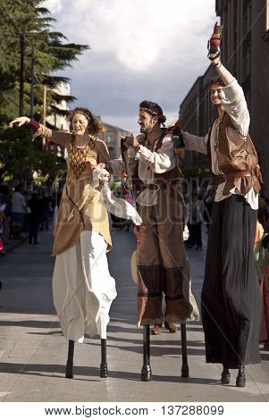 Enna, Italy - May 2016: Stilt walkers men and woman takes part in the medieval costume parade along the street. Tenth Edition of Historical Parade, 15 may 2016, Enna, Sicily