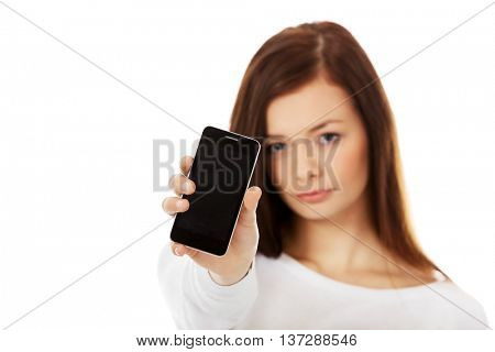 Young sad women showing broken touch screen mobile phone