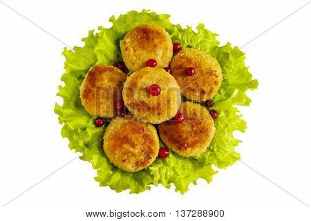 Roasted chicken cutlets on green lettuce. Isolated on white background. Top view.