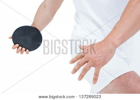 Mid section of athlete discus throwing on white background