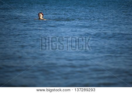 Young Woman Relaxing In Sea