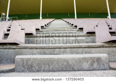Empty row of seats and steps in stadium