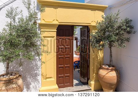 Doorway to a courtyard of greek house in Lindos. Island of Rhodes Greece