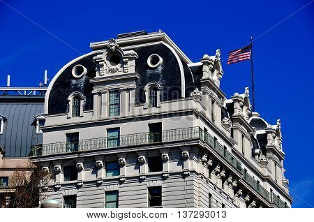 Washington DC - April 10 2014: Closeup of the beaux arts roof with flag of the legendary Willard Hotel on Pennsylvania Avenue *