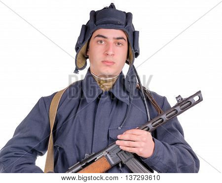 young Soviet pilot of tank with machine gun on white background