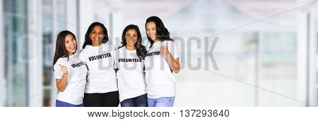 Group of young women who are volunteering for a project