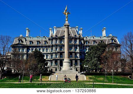 Washington DC - April 10 2014: Old Executive Office Building and War Memorial Column