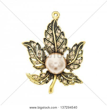 pendant in the form of a maple leaf with pearl in white background