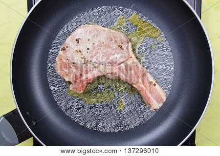 Chef cooking porkchop in frying pan/ cooking steak concept
