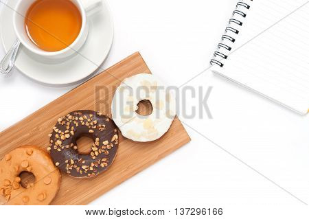 Delicious Donuts With Icing, Book And Tae In Wood Plate Isolated On White