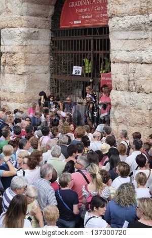 VERONA, ITALY - JULY, 4, 2016: crowd of spectators near the Arena of Verona entrance (in italian - Arena di Verona) - ancient amphitheater, today used as a theatre stage