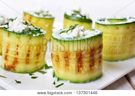 Appetizer grilled zucchini rolls with curd cheese