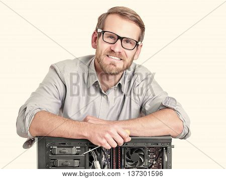 Master of computer repair isolated on white. Computer repair concept.