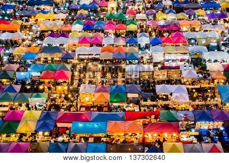 Colorful Food Stalls At Rod Fai Night Market In Bangkok, Thailand, Day To Night Time-lapse.