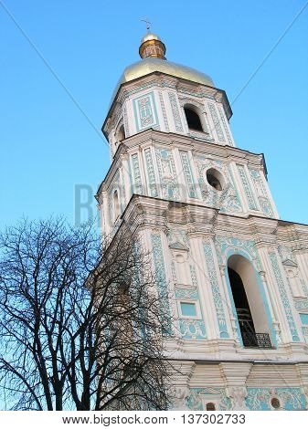 Old bell tower of St. Sophia Cathedral in Kiev on a background of blue sky