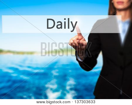 Daily - Female Touching Virtual Button.