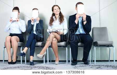 Human resource concept Young businessman holding white billboard and waiting for job interview