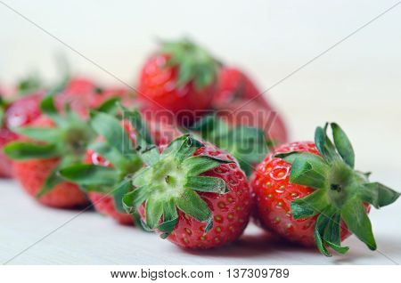 Strawberry fruit with flash filled on wooden board (Other names are Fragaria strawberry Fragaria ananassa)