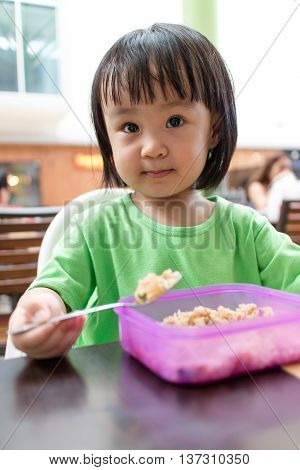 Asian Little Chinese Girl Eating Fried Rice