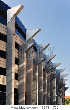 Wroclaw, Poland - October 16, 2015: Facade of a modern multistory parking. A wall with protruding angular elements in perspective. Wroclaw, Poland.