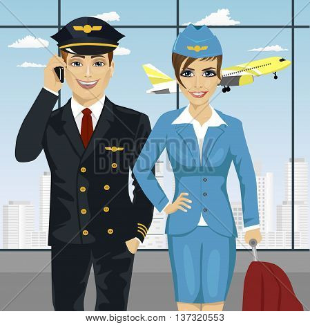 pilot and air hostess in uniform at the airport