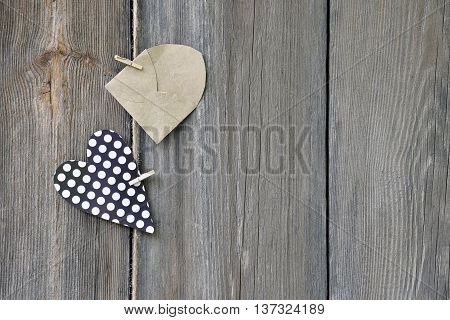 Rustic style. Country life. Fashionable life. Open your senses. Love. Passion. Courtship. Message. Surprise. Heart with polka dots and envelope on an old wooden background.