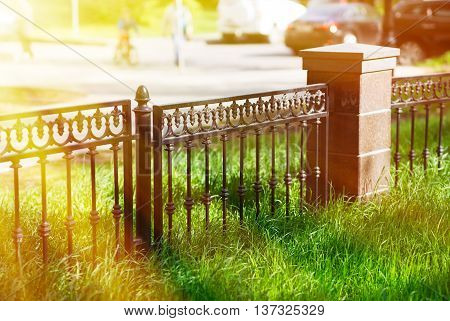 Horizontal park fence border bokeh with light leak background