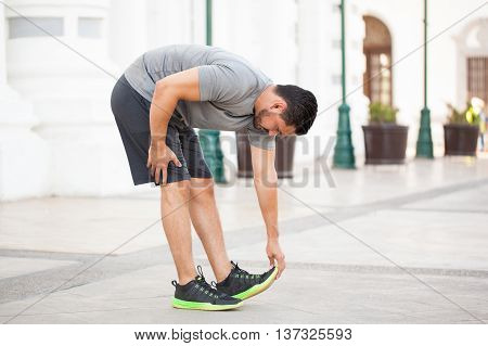 Man Stretching Before Working Out Outdoors