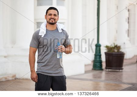 Man Drinking Water After Running Outdoors