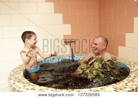 Grandfaher With Grandson Refreshing In Jacuzzi