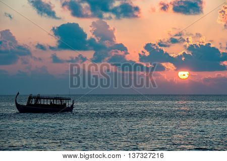 Golden Sunset In Maldives With Donhi