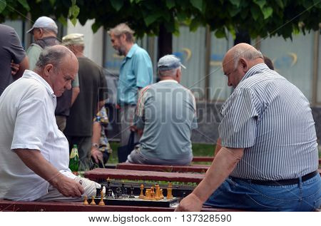 Old men are playing chess in a park, on July 6, 2016 in Kiev, Ukraine