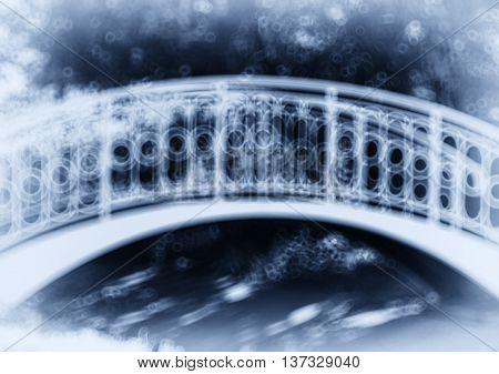 Horizontal blue park arc bridge bokeh vignette abstraction background