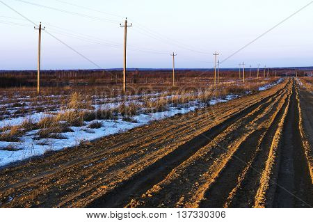 Russian countryside offroad with power lines background