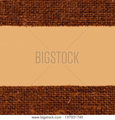 Textile weft fabric style khaki canvas jutesack material close-up background