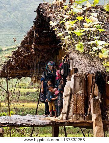 YEN BAI, VIETNAM, June 18, 2016 Hmong family, high mountains, Mu Cang Chai, Yen Bai, happy with simple stilt houses