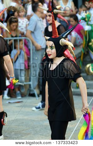 Montenegro, Herceg Novi - 04/06/2016: The girl, dressed in a fancy suit jester. 10 International Children's Carnival